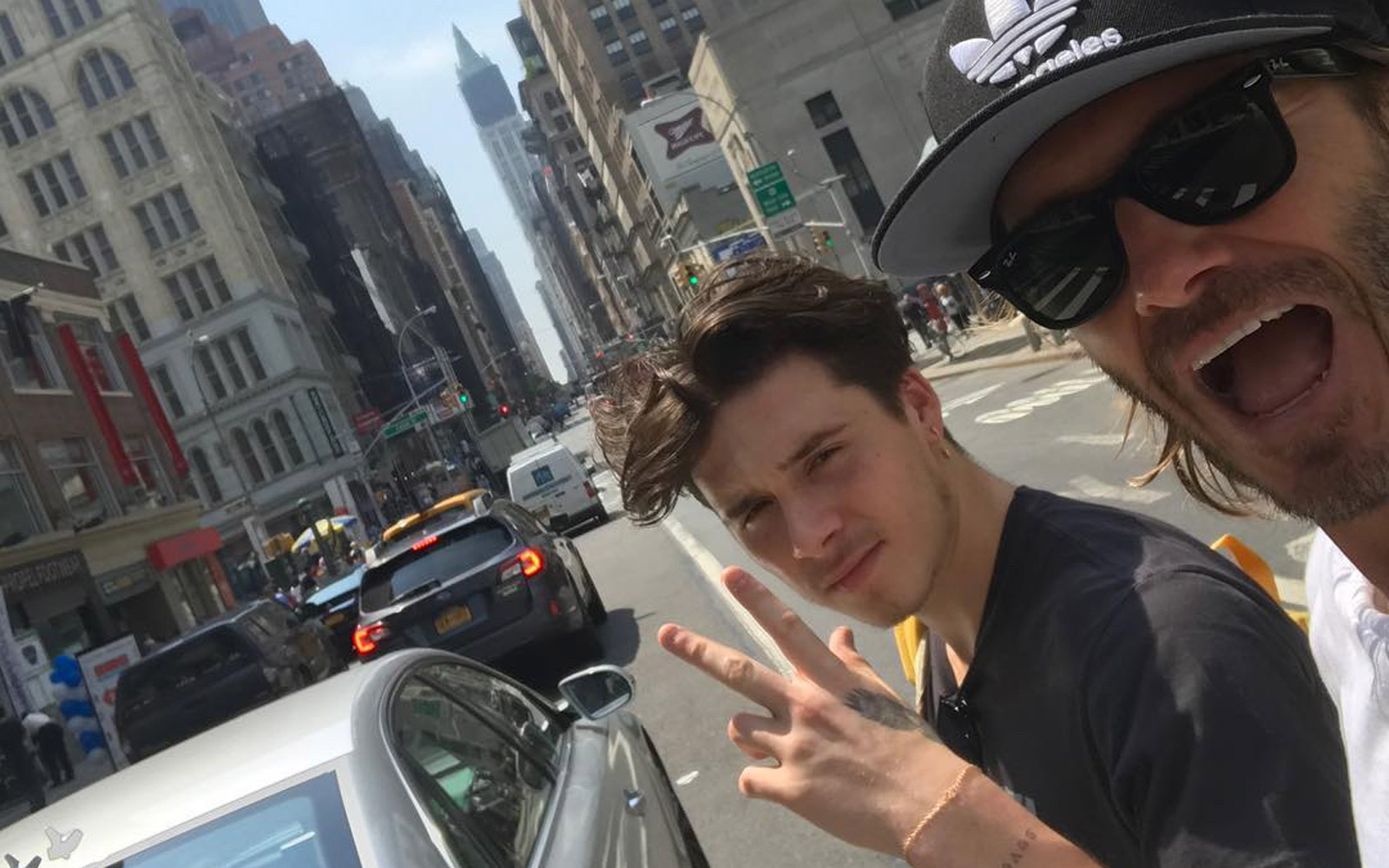 David and Brooklyn Beckham tour NYC