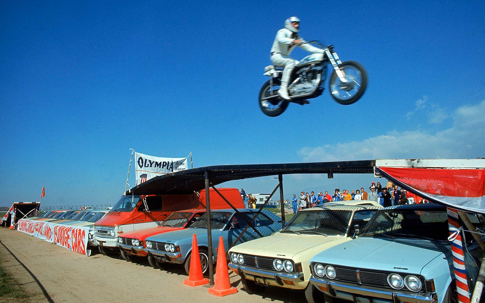 American stuntcyclist and daredevil Evel Knievel soars over 17 cars, 1971. Later that year, he broke the car jumping record clearing 19 vehicles