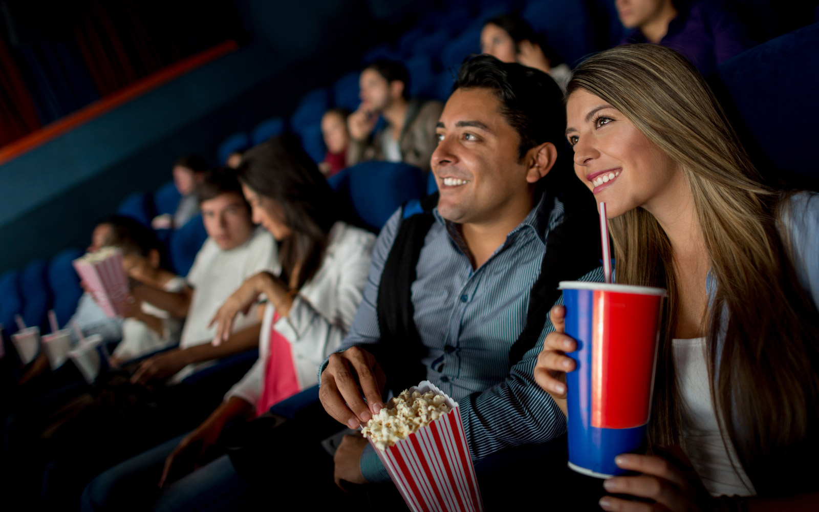 Happy couple on a date at the movies