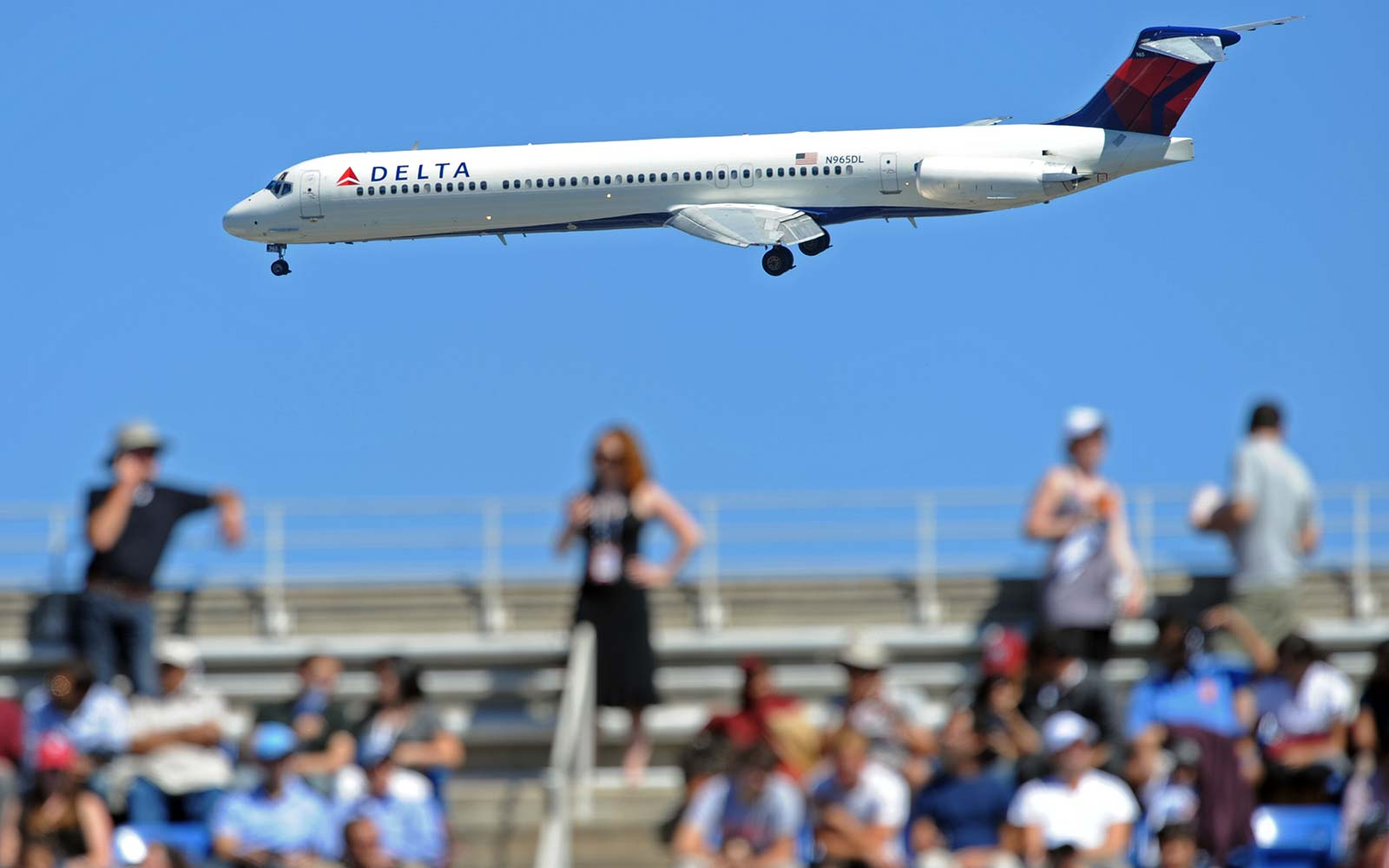 A Delta jet makes its approach to nearby La Guardia Airport past the Arthur Ashe Stadium during the US Open semifinal match between Rafael Nadal of Spain and Mikhail Youzhny of Russia in New York