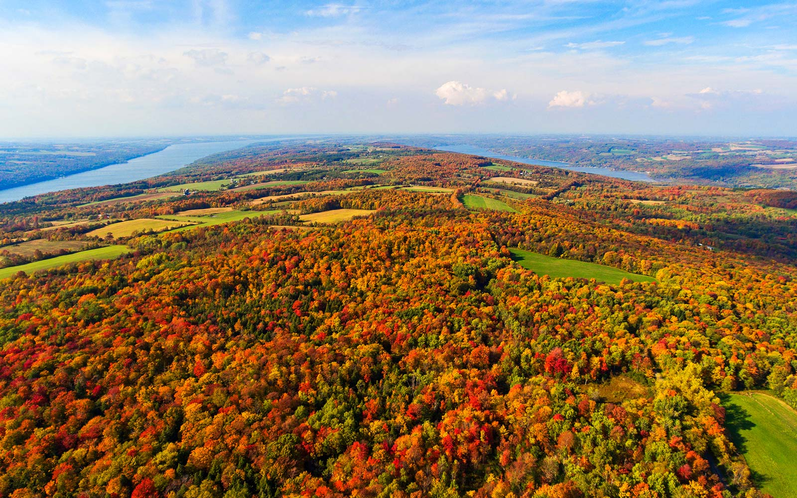An aerial shot of the Finger Lakes in upstate New York during a beautiful and colorful autumn day in the country foliage