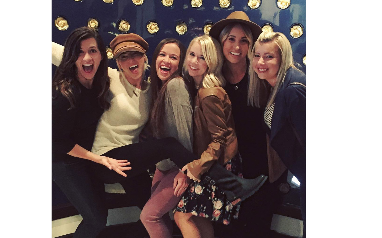Julianne Hough taking a picture with her friends