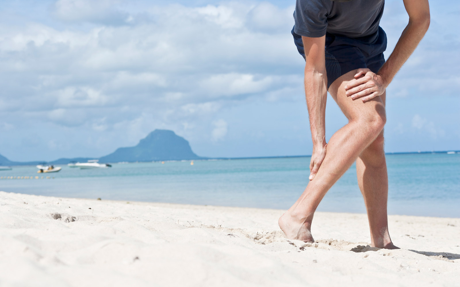 """""""Typical pain in upper achilles tendon (muscular/ligamental transition) of a male jogger.Location: Flic en Flac, Mauritius."""""""