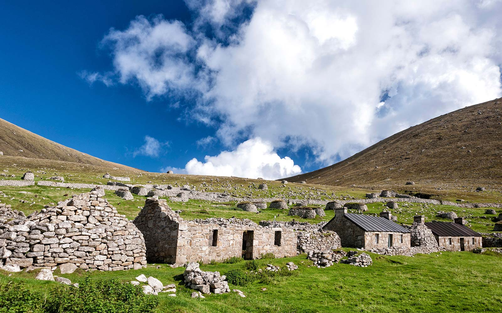 A view of Main Street, Village Bay, St. Kilda, showing both the ancient and newer blackhouses Scotland