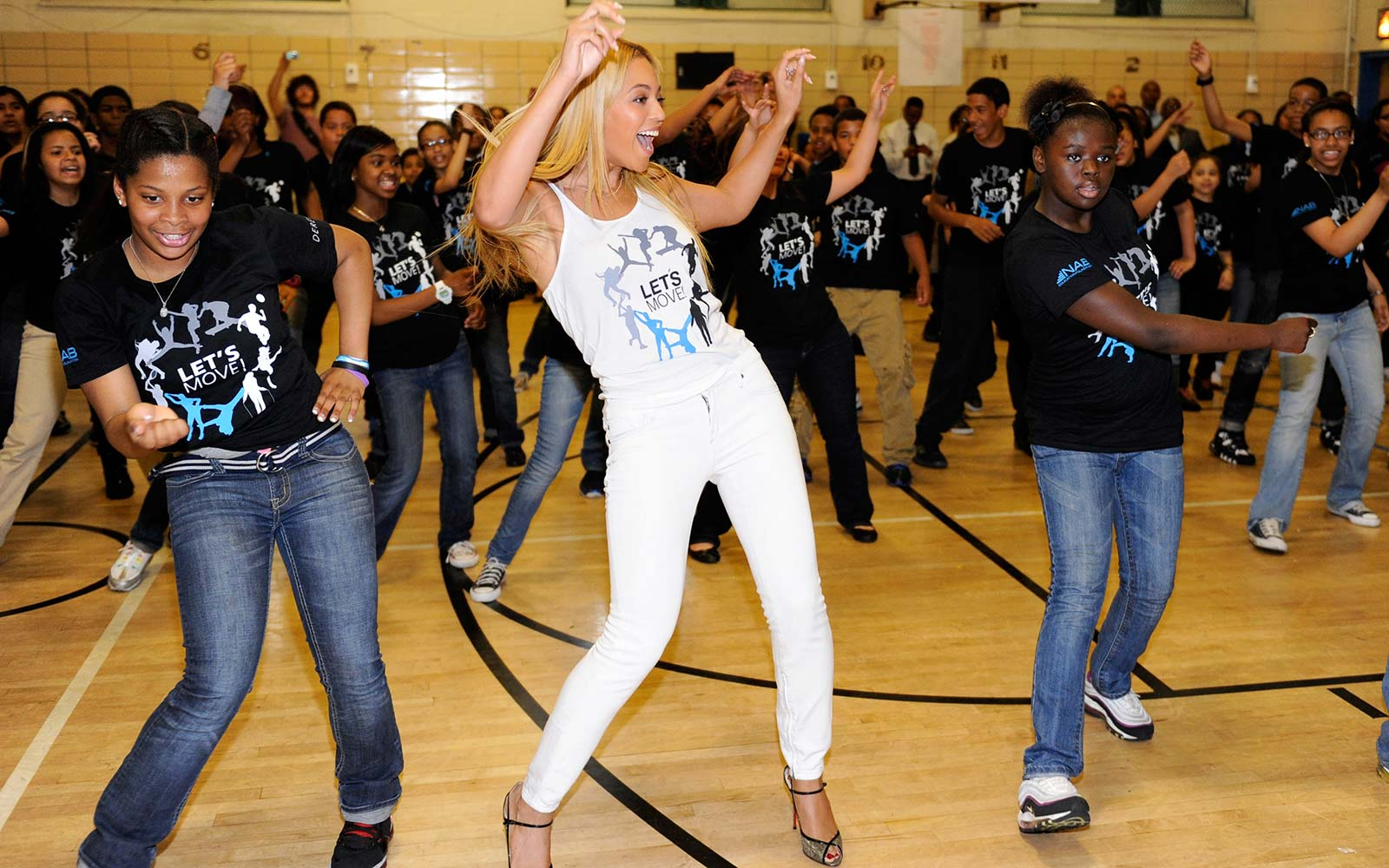 """Beyonce surprises students at PS/MS 161 in Harlem as part of First Lady Michelle Obama's """"Let's Move"""" initiative to fight childhood obesity. The students were dancing to """"Move Your Body,"""""""