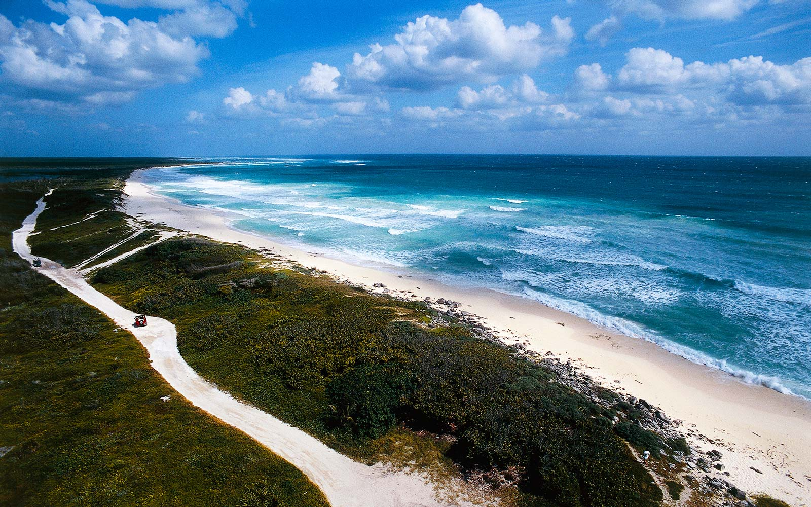 White sand beach and road on the east coast of Cozumel island, Quintana Roo, Mexico