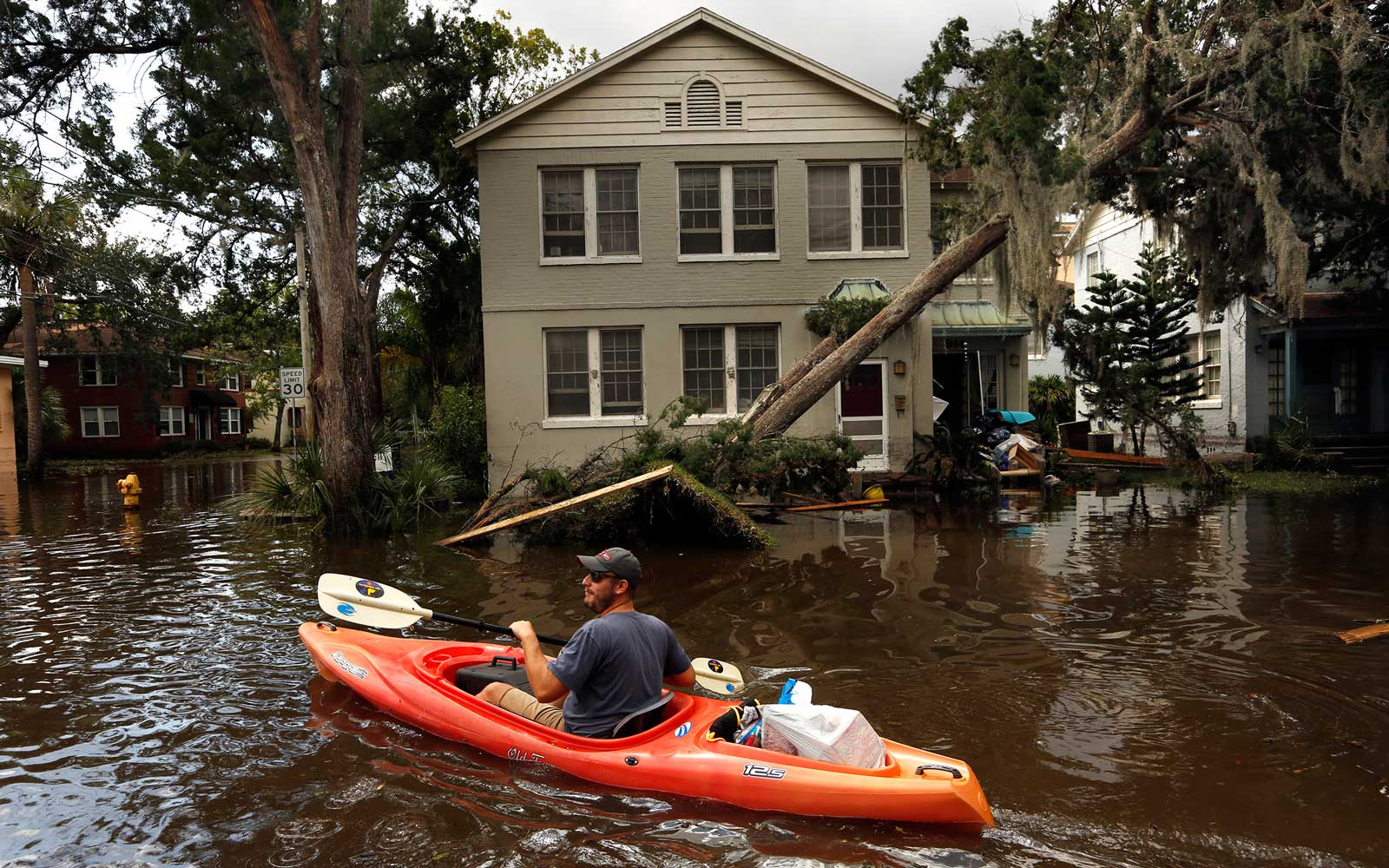 Joshua Young takes some of his personal belonging out by kayak after flooding hit his apartment building during Hurricane Irma on September 12, 2017 in the San Marco area of Jacksonville, Florida