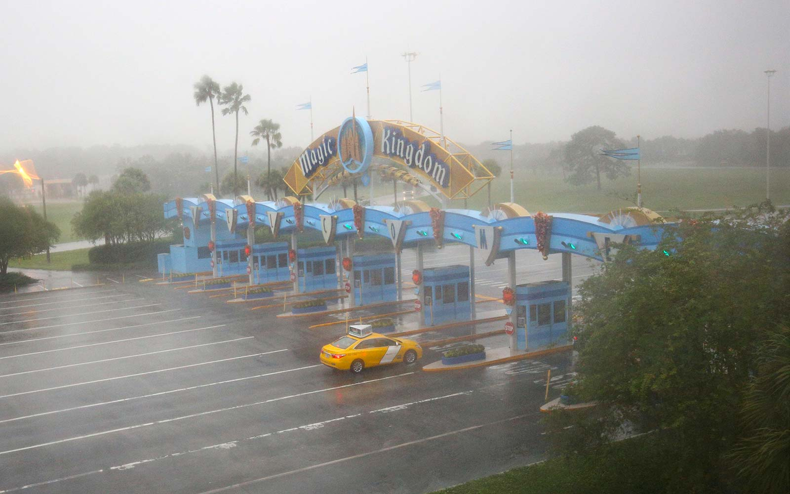 A lone taxi heads toward the Walt Disney World Resort area in Orlando, Florida, before the landfall of Hurricane Matthew, on October 6, 2016. Some three million people on the US southeast coast faced an urgent evacuation order Thursday as monstrous Hurri