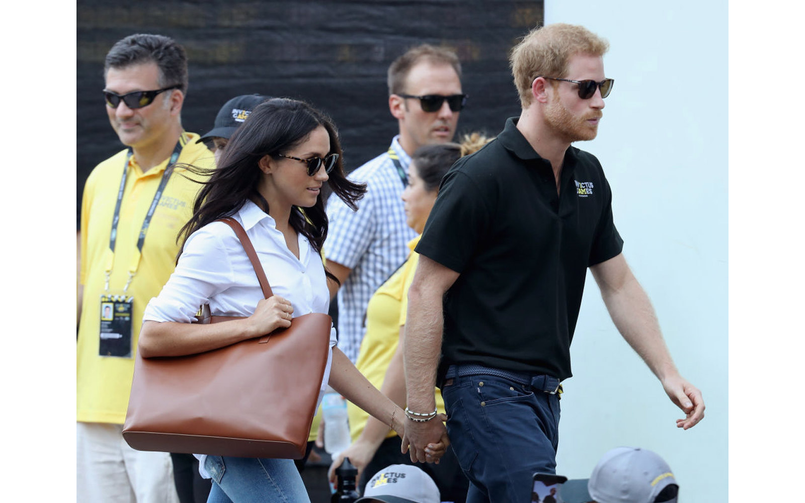Meghan Markle and Prince Harry hold hands at Invictus Games Toronto 2017 - Day 3