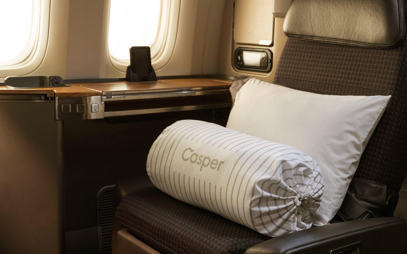 Casper pillow on American Airlines seat.