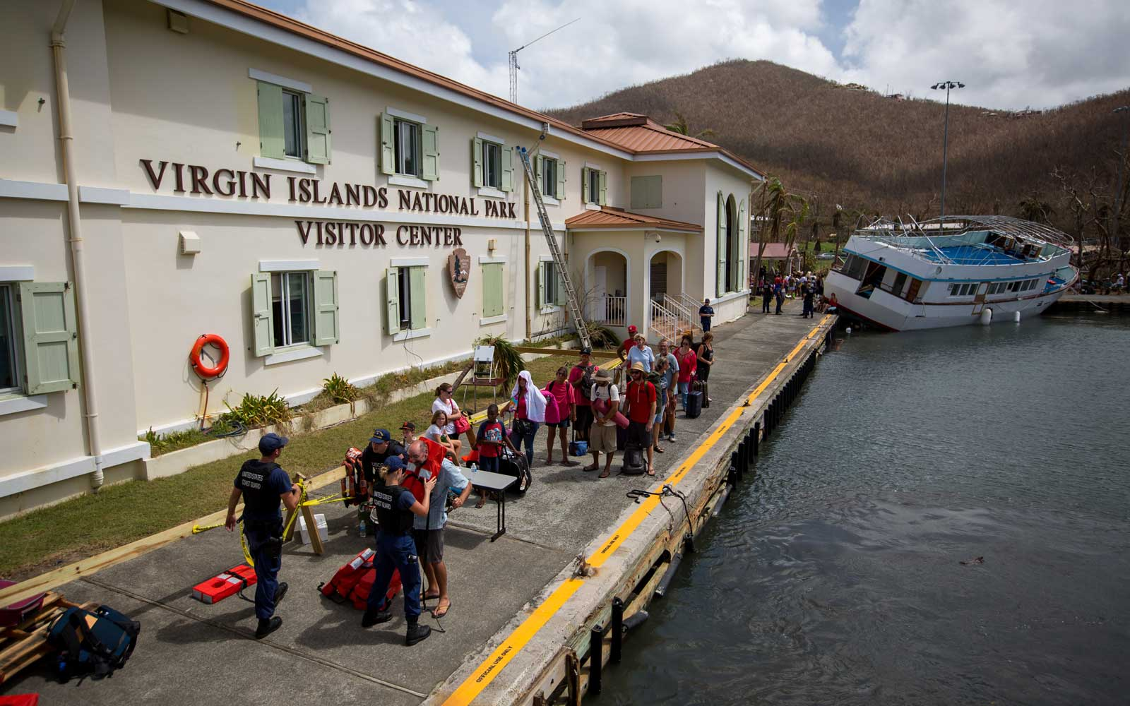 Members of the U.S. Coast Guard process evacuees after Hurricane Irma in St John, U.S. Virgin Islands, on Tuesday, Sept. 12, 2017