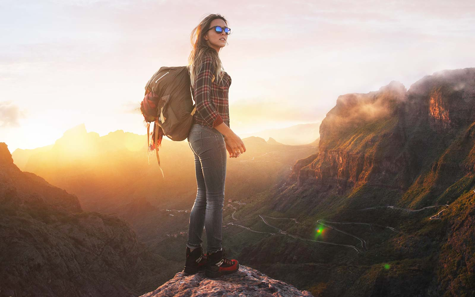 Female rock sunset hike mountain women adventure outdoor