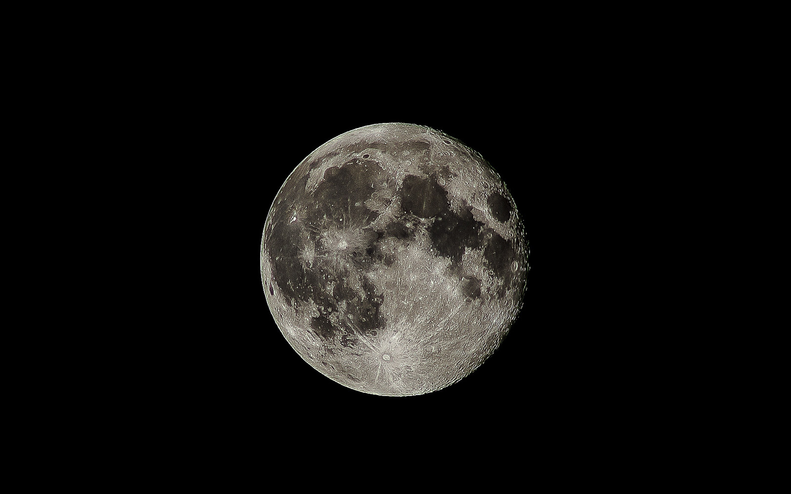 Low Angle View Of Full Moon At Night