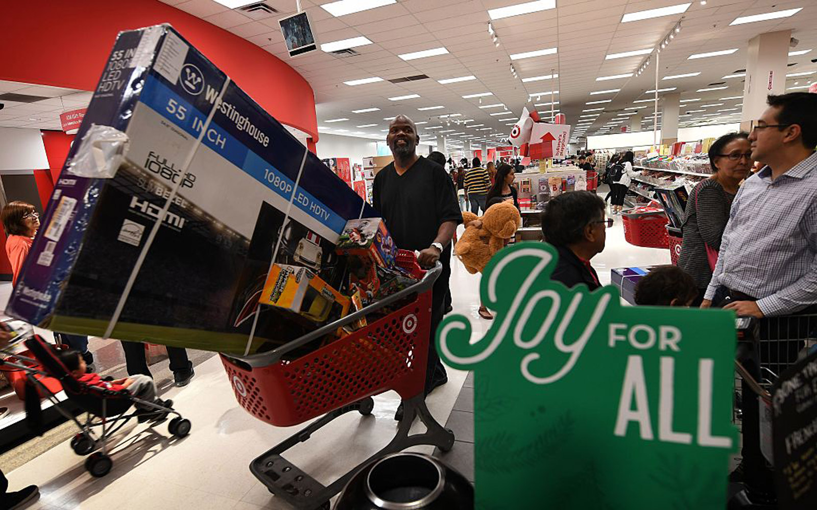 "Thanksgiving Day shoppers push loaded up carts during the ""Black Friday"" sales at a Target store"