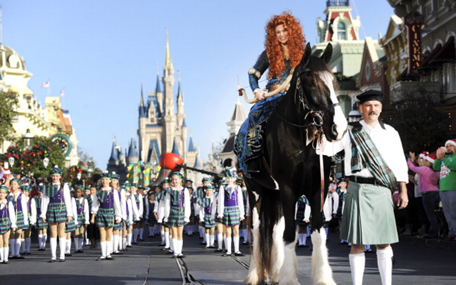 "Princess Merida -- from the Disney-Pixar hit film ""Brave"" -- sits atop her horse ""Angus"" Dec. 1, 2012 during a break in taping the ""Disney Parks Christmas Day Parade"" TV special in the Magic Kingdom park"