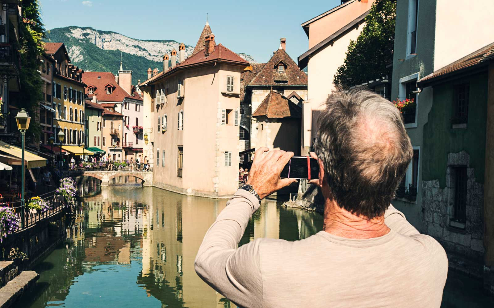 Older man taking scenic image