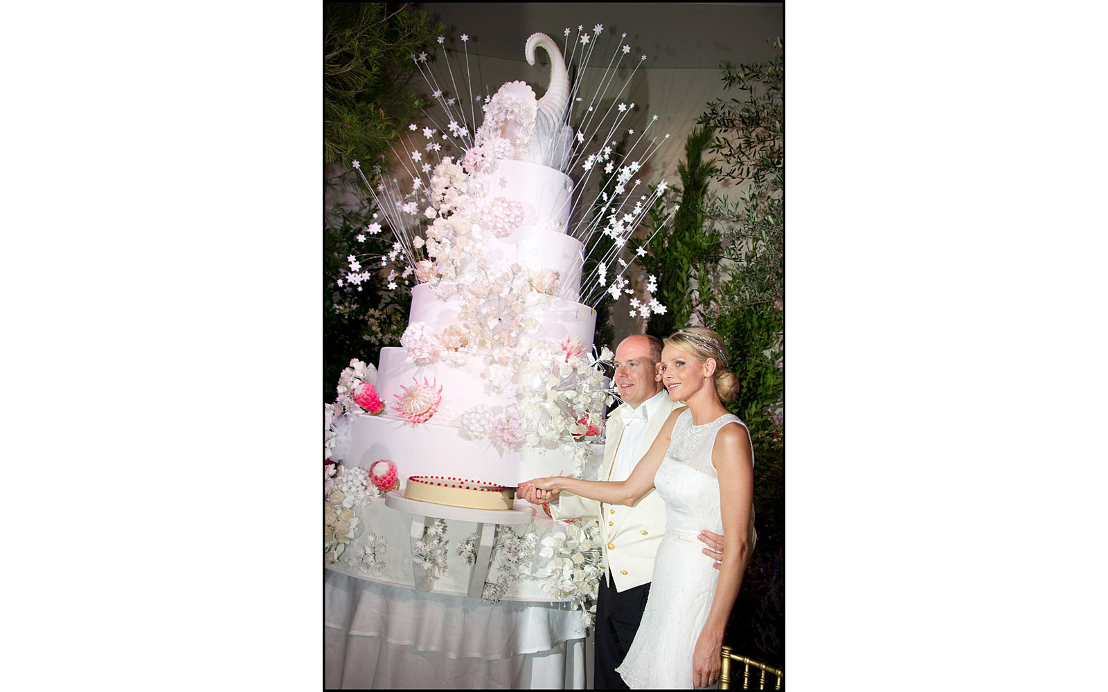 Prince Albert II of Monaco and Princess Charlene of Monaco cut the wedding cake during the dinner at Opera terraces
