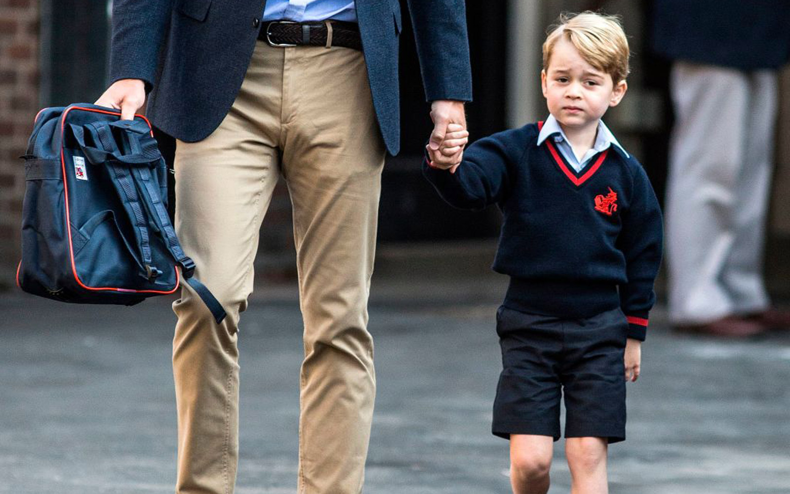 Britain's Prince George accompanied by Britain's Prince William, Duke of Cambridge arrives for his first day of school at Thomas's school