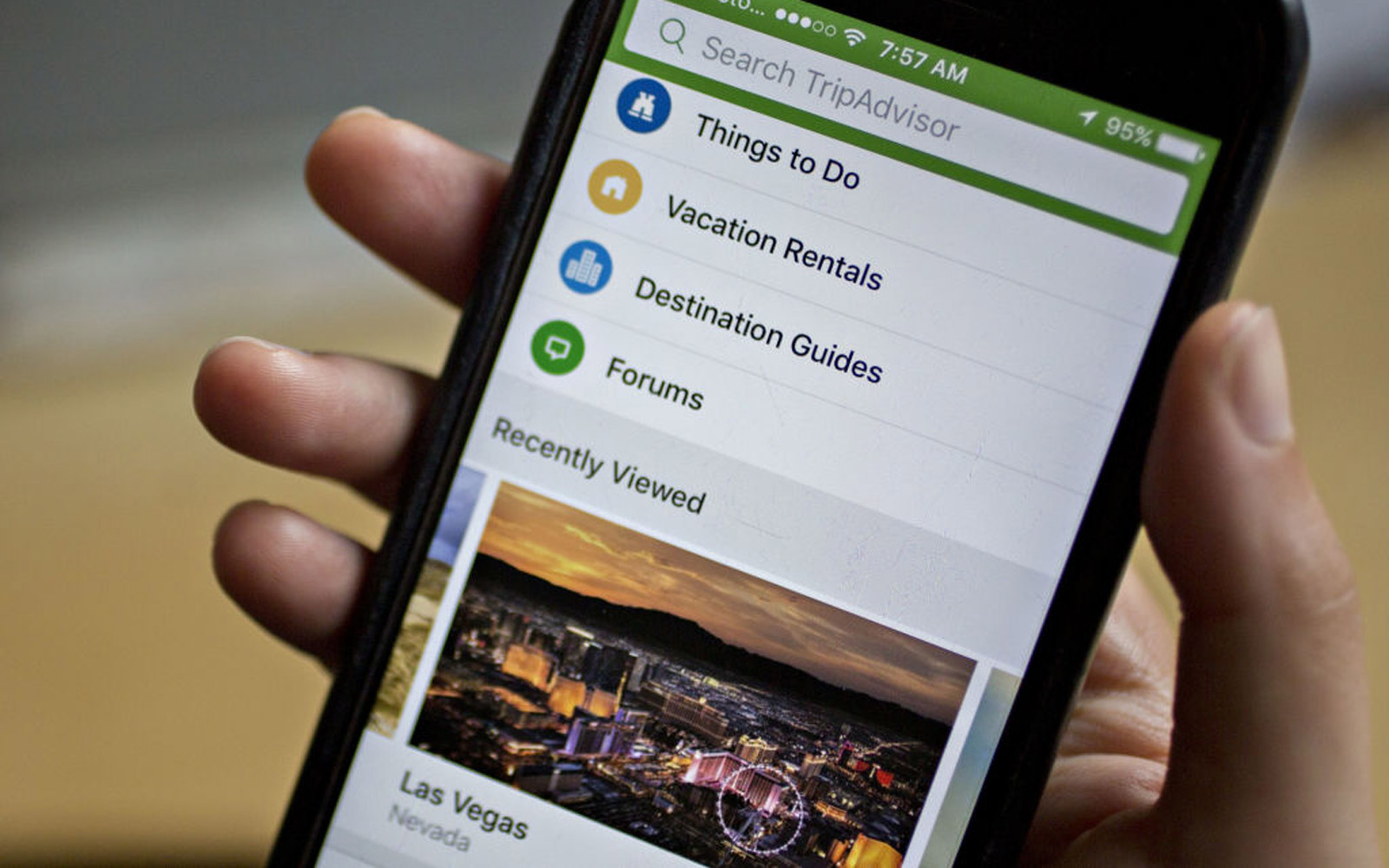 The TripAdvisor Inc. application is demonstrated on an Apple Inc. iPhone