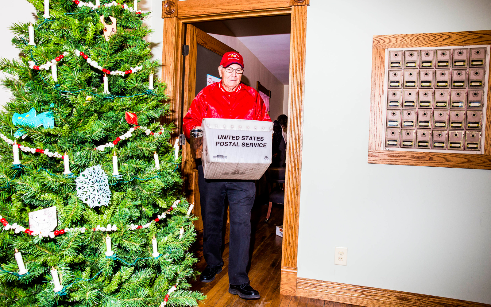 Volunteer Elf helps with mail