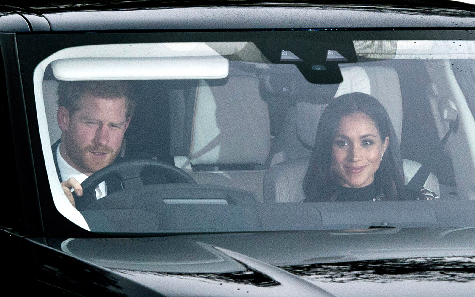 Prince Harry and Meghan Markle in a car