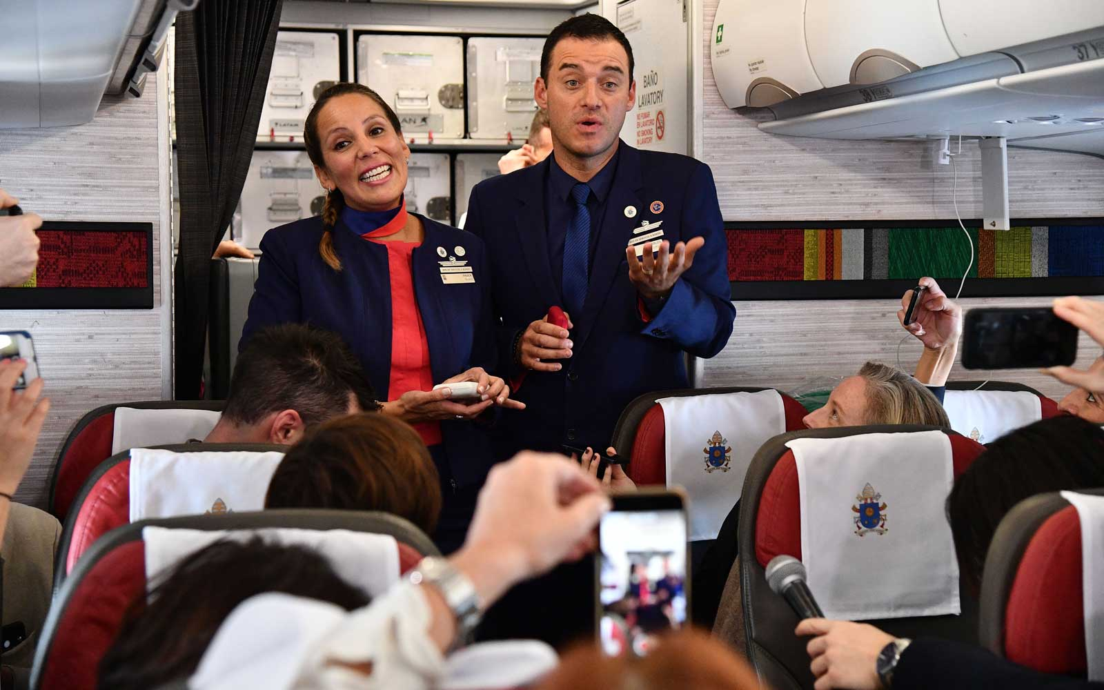 Crew members Paula Podest (L) and Carlos Ciuffardi smile after being married by Pope Francis during the flight between Santiago and the northern city of Iquique on January 18, 2018