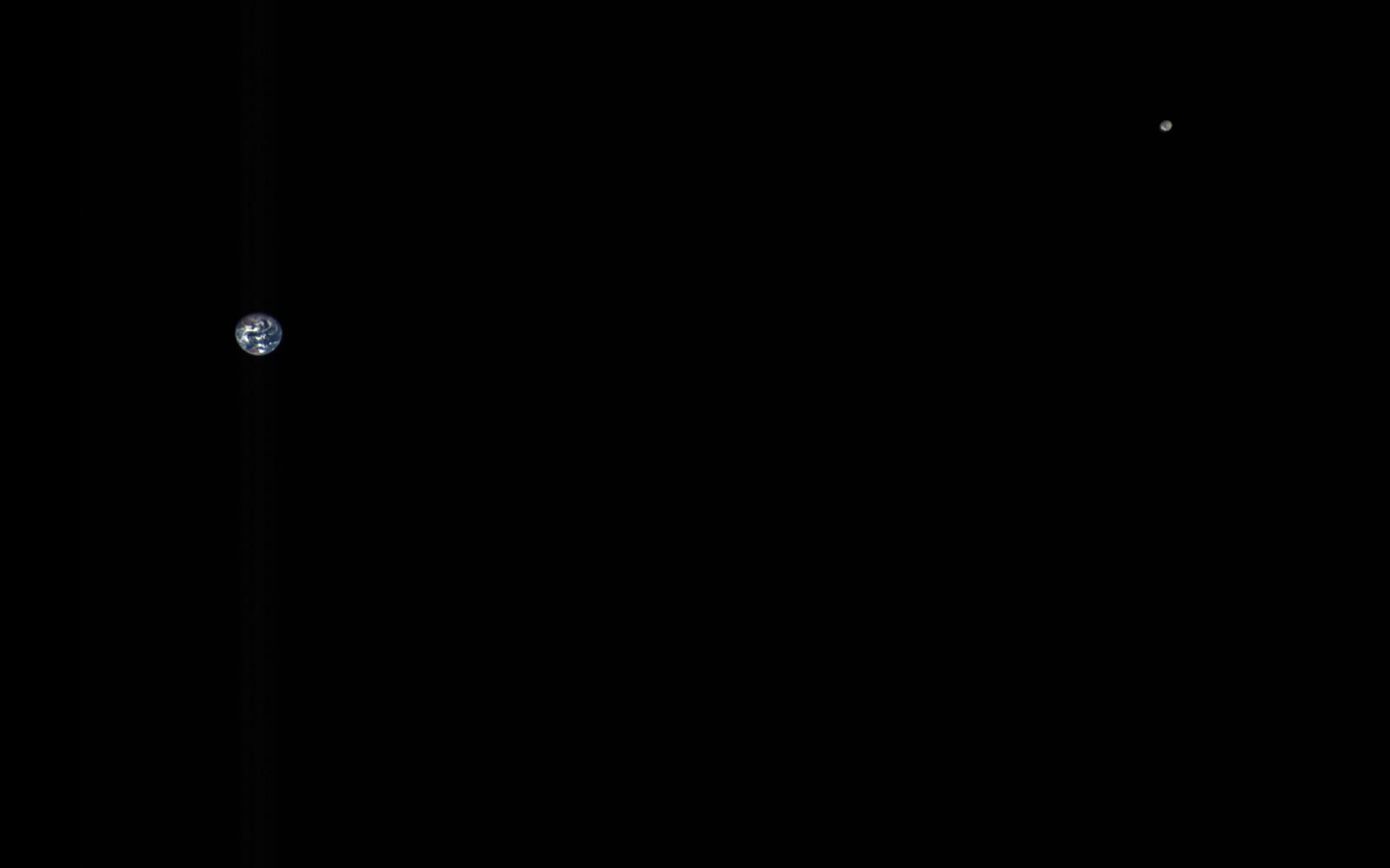 This composite image of the Earth and Moon is OSIRIS-REx's MapCam instrument data on October 2, 2017