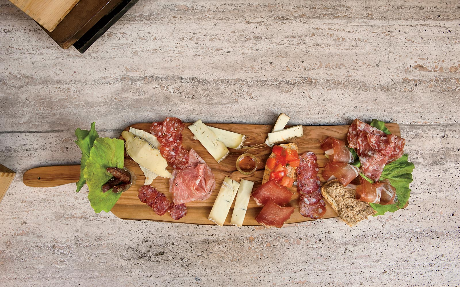 Meats and cheese at Il Bacchino restaurant, in Italy
