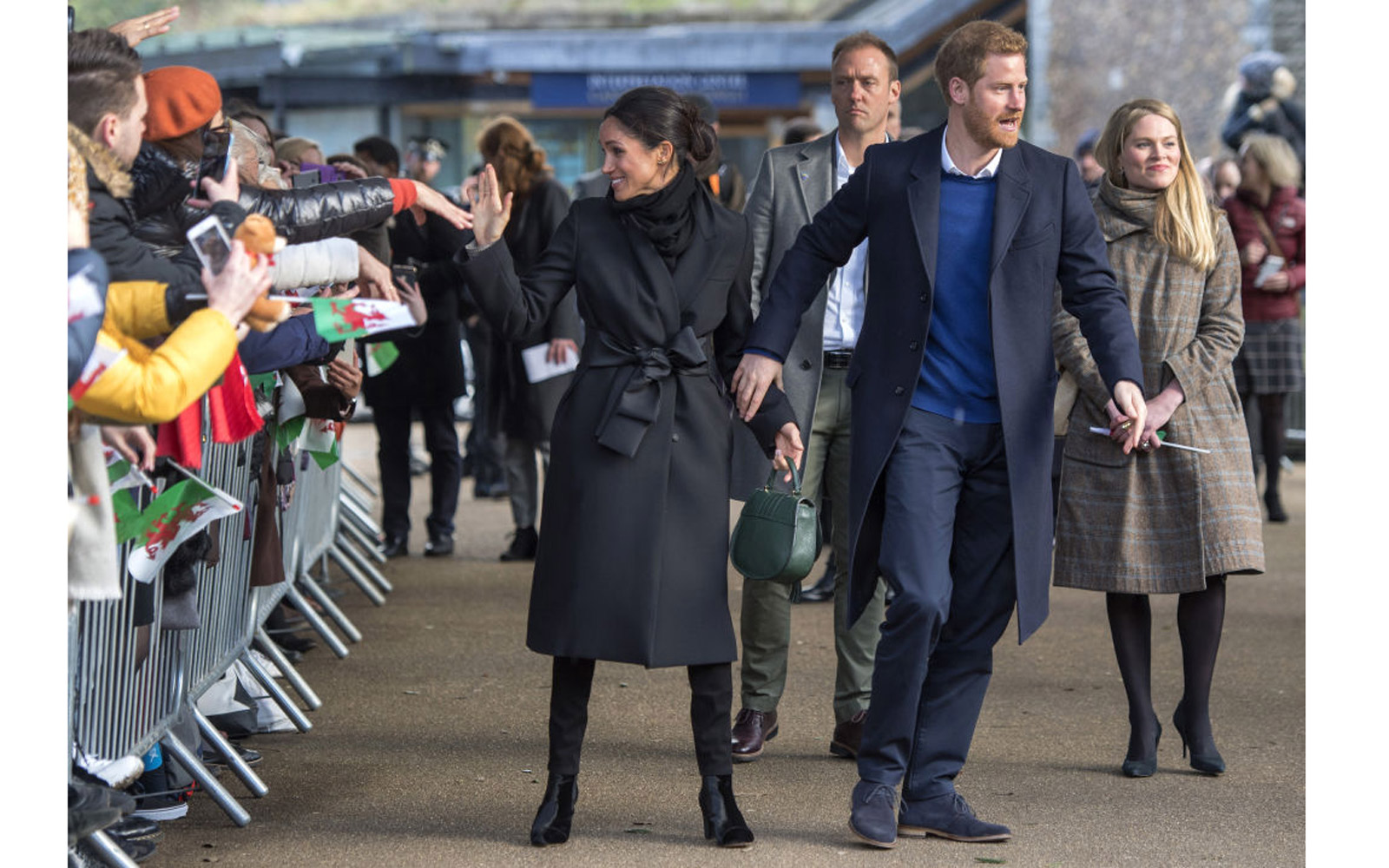 Britain's Prince Harry and fiancée US actress Meghan Markle greets well-wishers on arrival at Cardiff Castle in Cardiff, south Wales on January 18, 2018