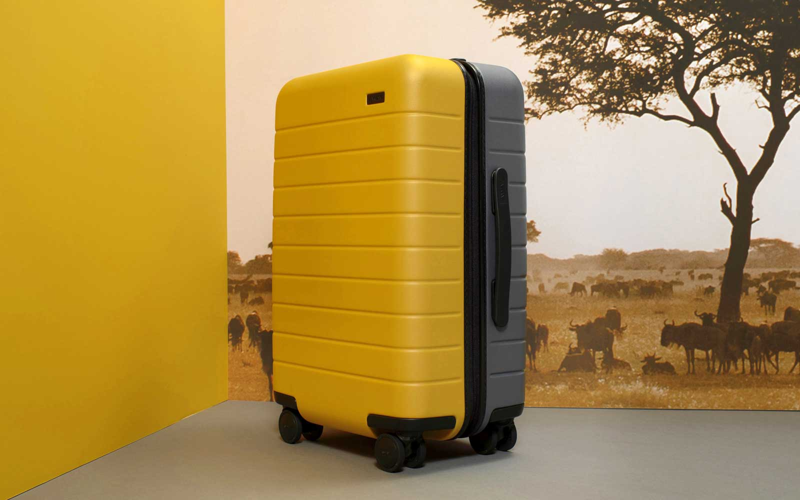 Yellow and gray suitcase from Away