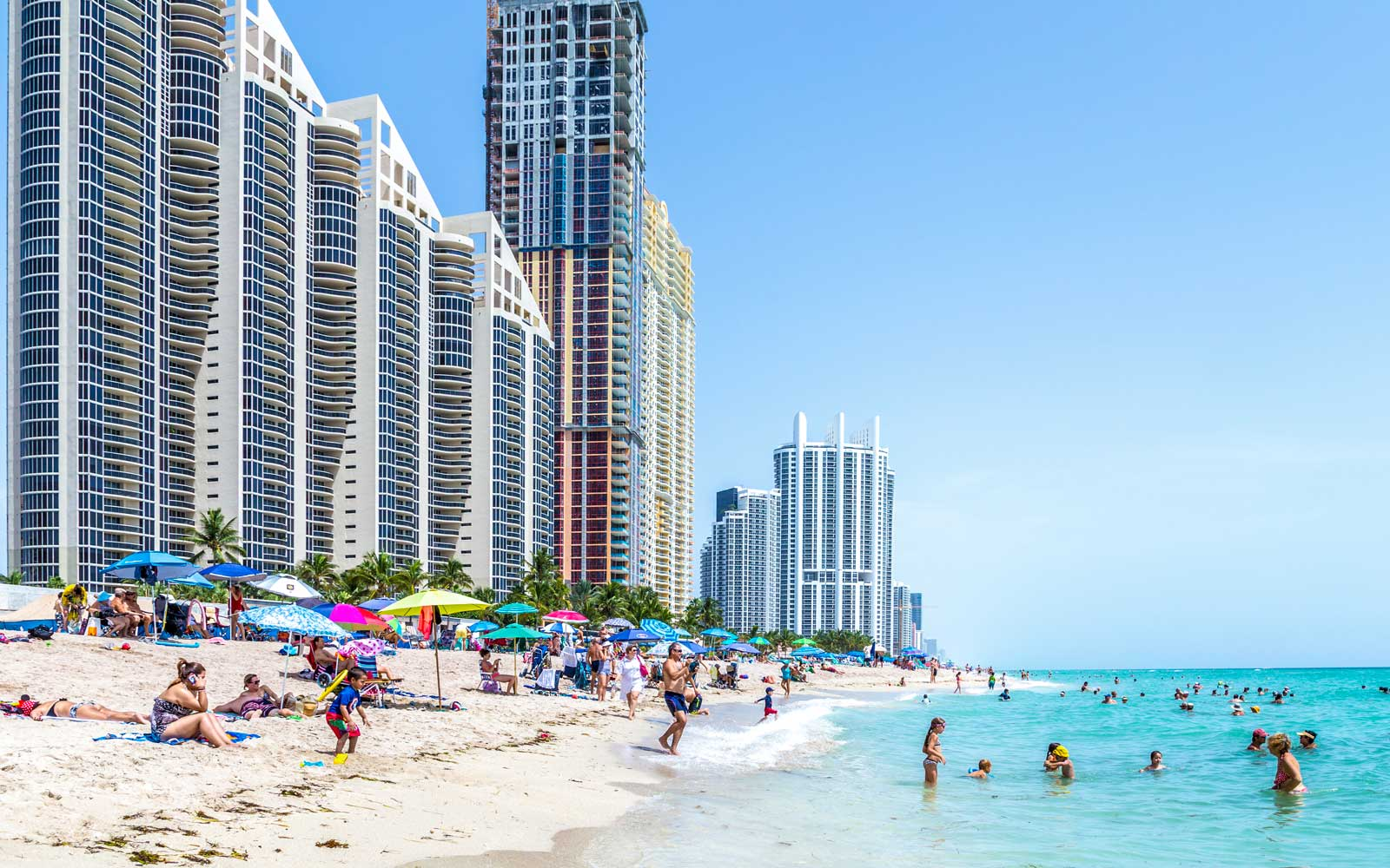 People enjoy Jade beach in Sunny Isles Beach, Florida, USA