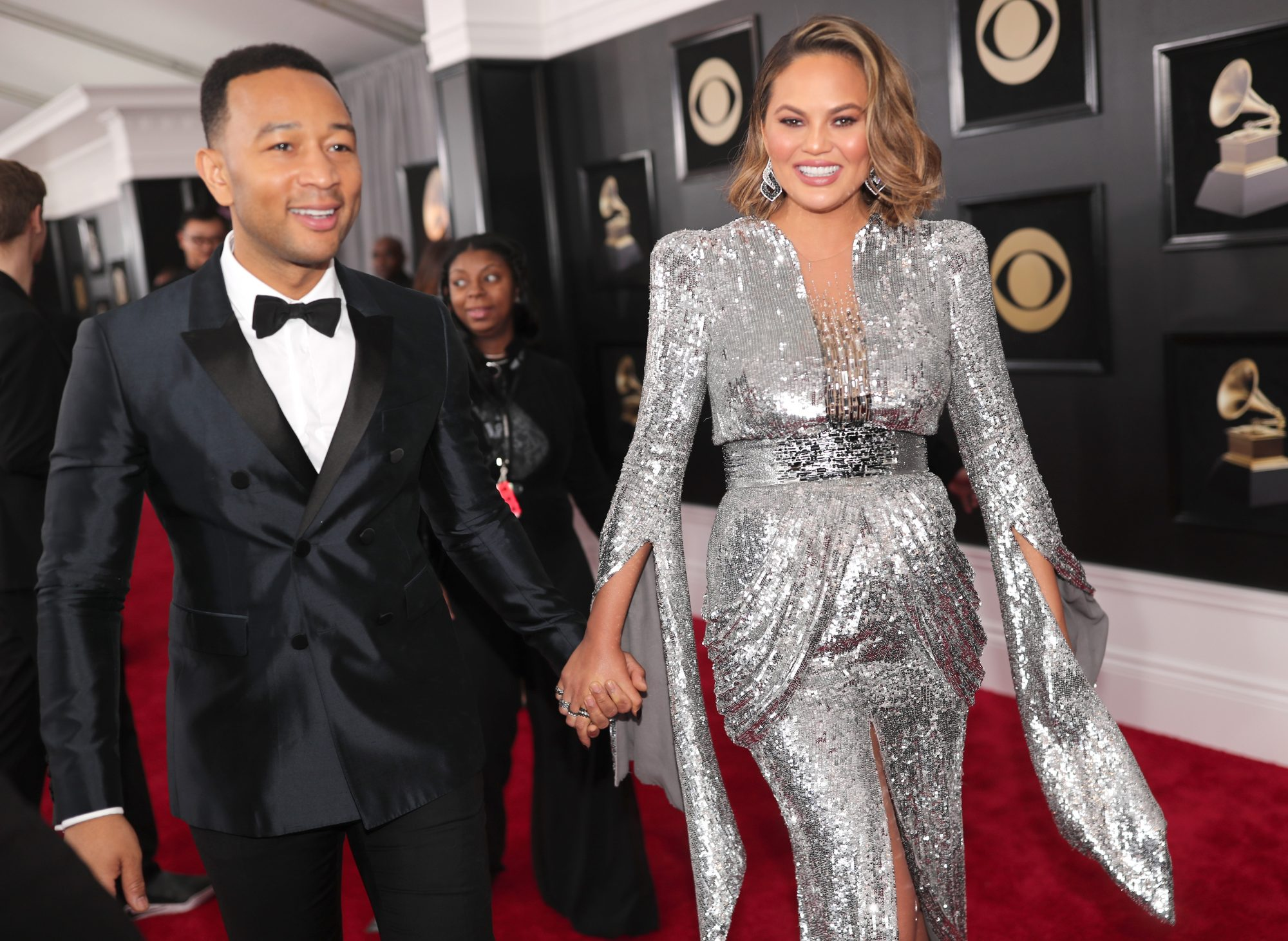Chrissy Teigen and John Legend on the red carpet at the 2018 Grammy Awards.