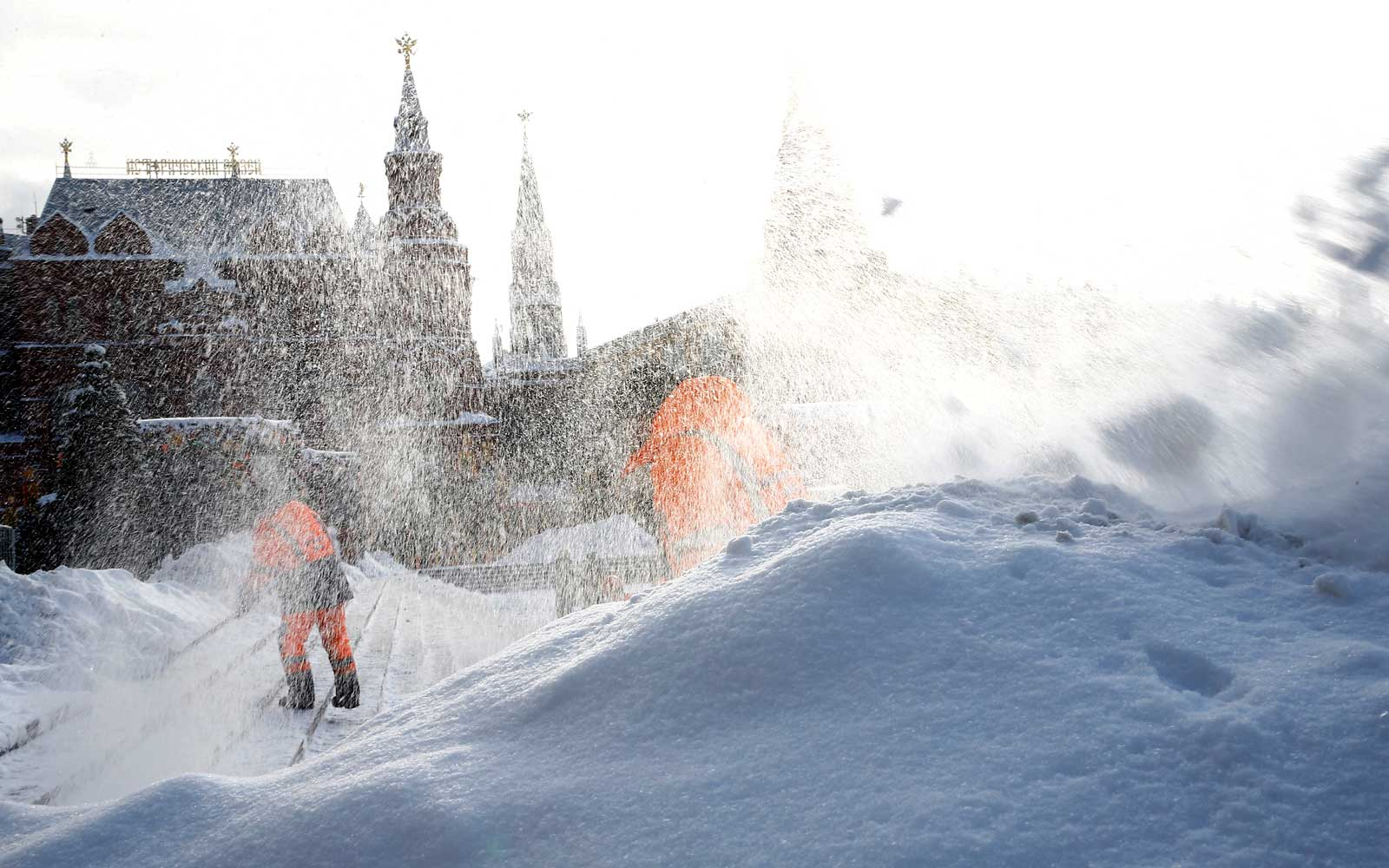 A man cleans the road covered by snow on the Manezhnaya Square as State Historical Museum is seen in the background following four days of snowfall in Moscow, Russia on February 06, 2018.