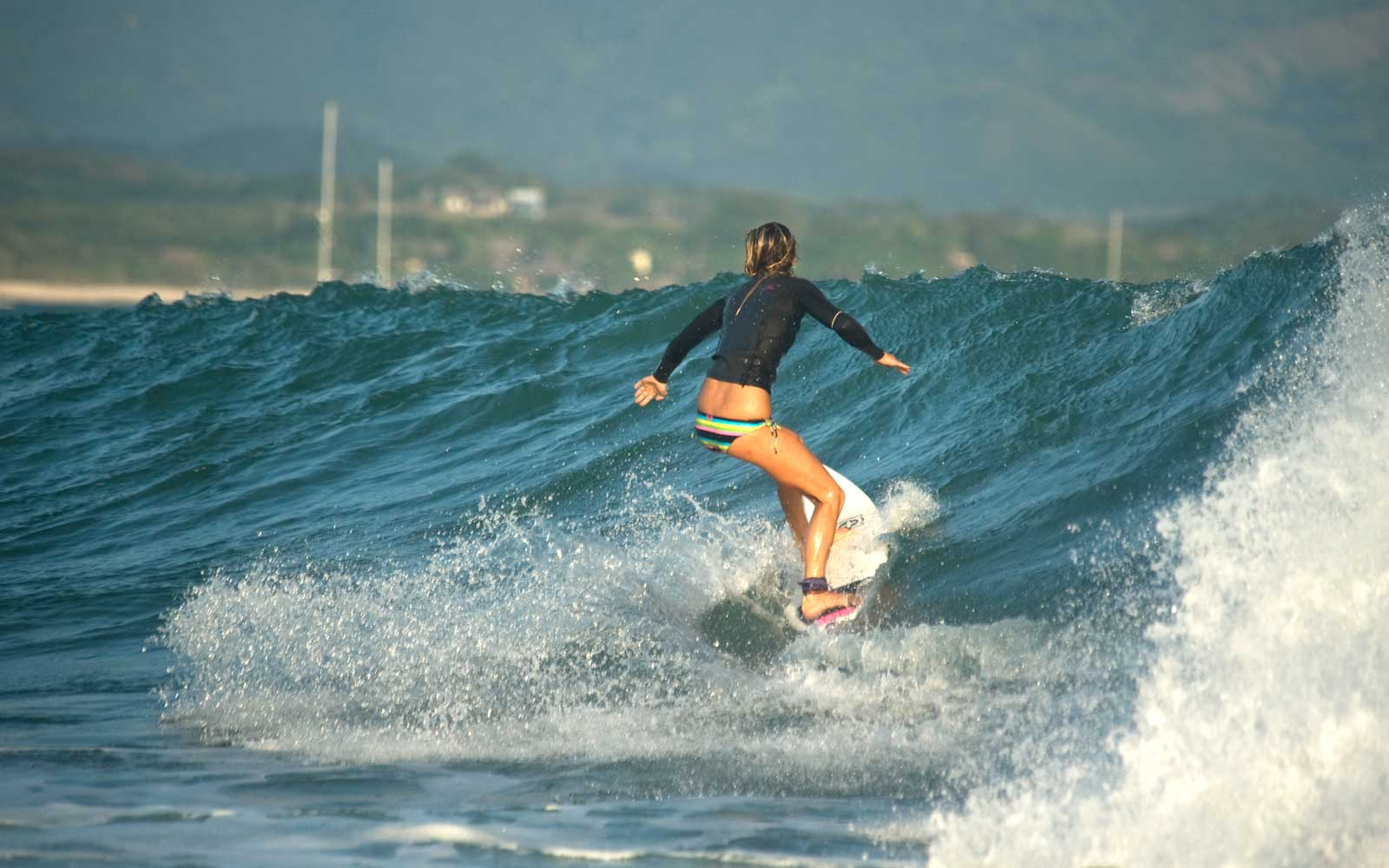 Woman surfing at Punta Mita, Mexico