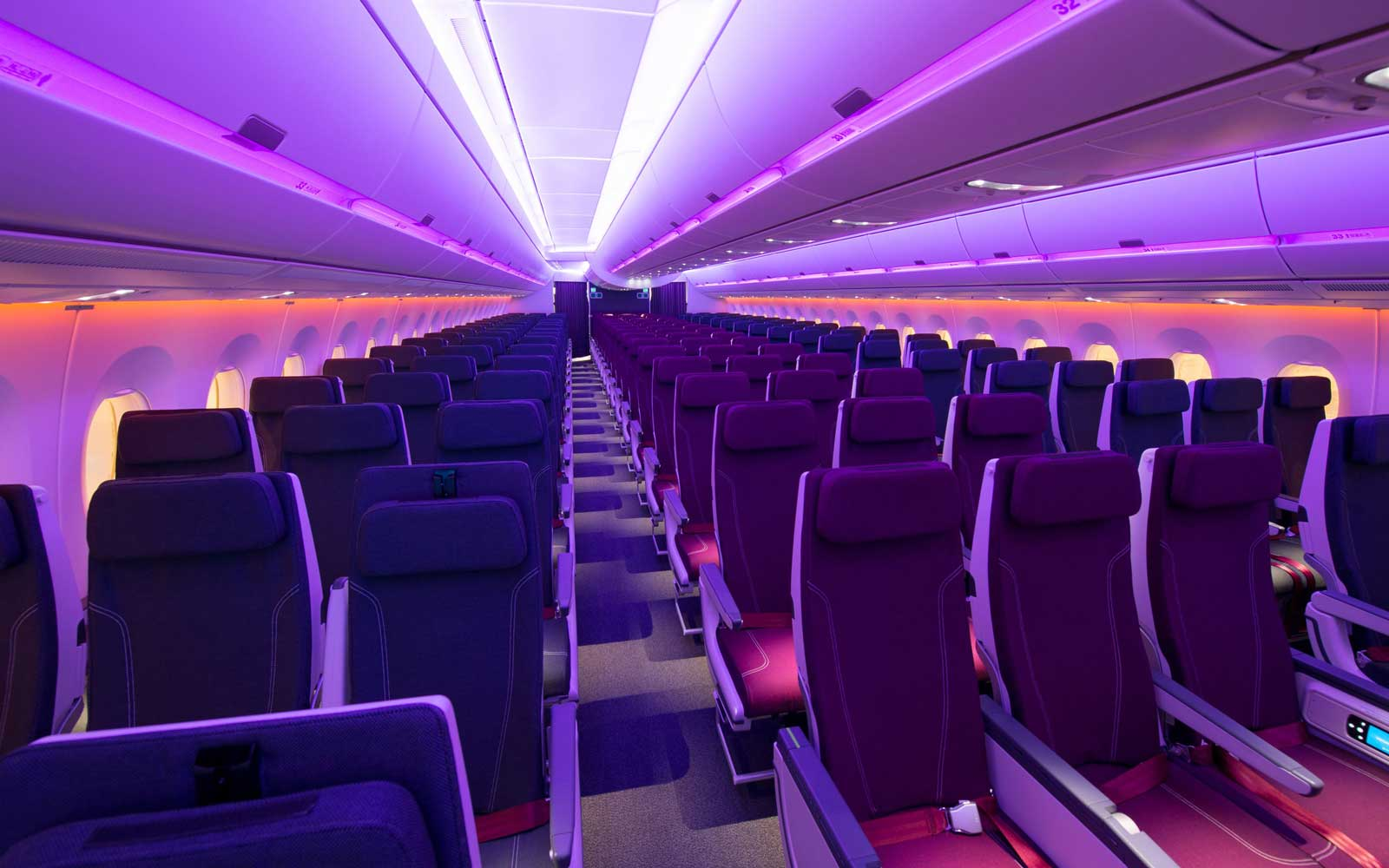Lighted economy cabin of Qatar Airways Airbus A350-1000