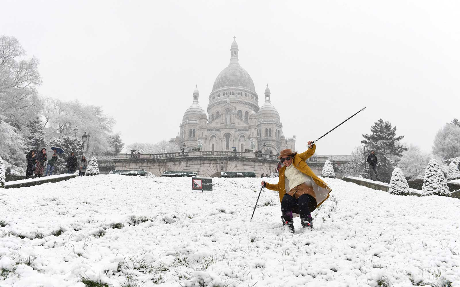 A woman is skiing on the snow-covered Montmartre hill in front of the Basilica of the Sacred Heart on February 6, 2018 in Paris.