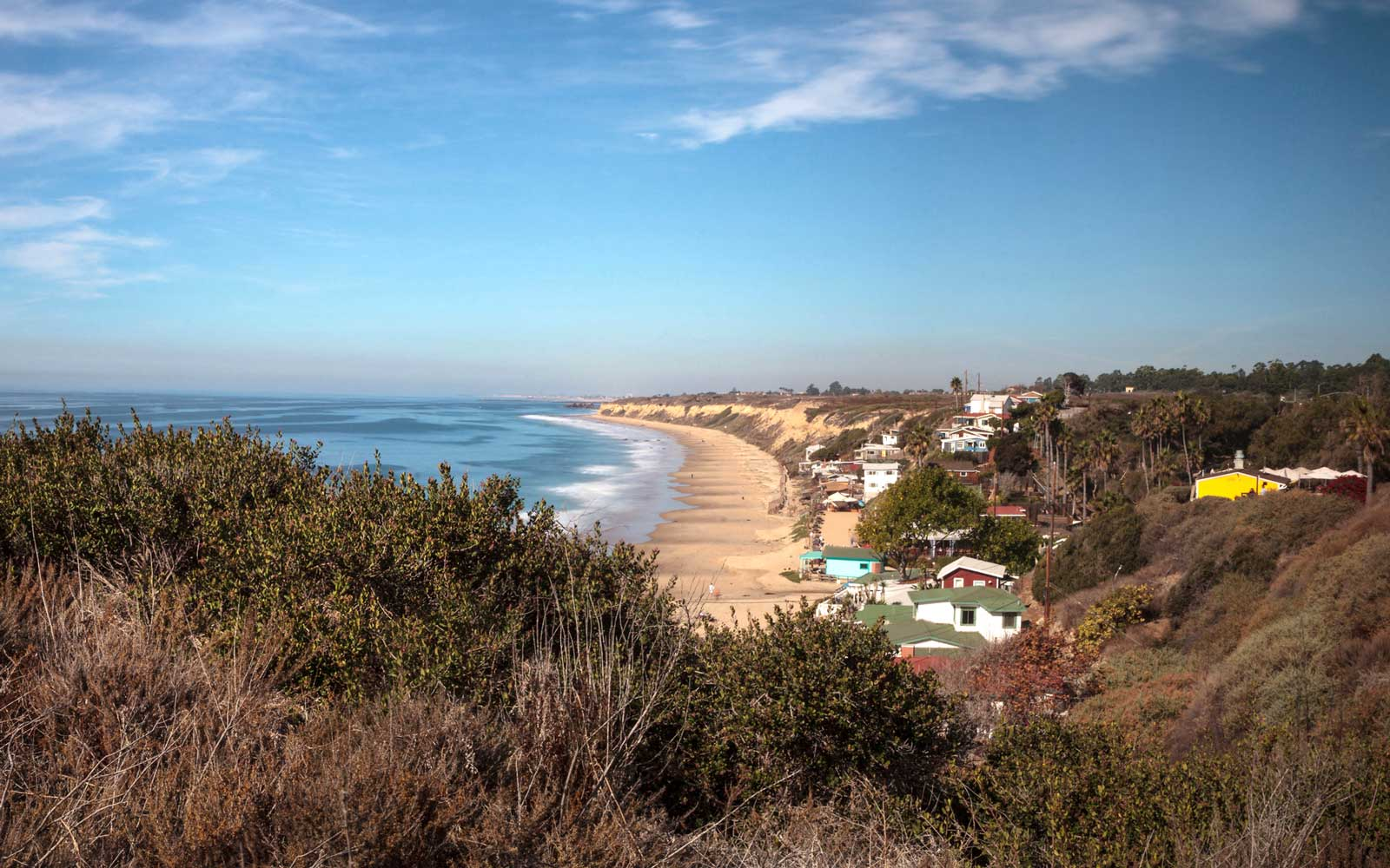 Beach cottages line Crystal Cove State Park beach