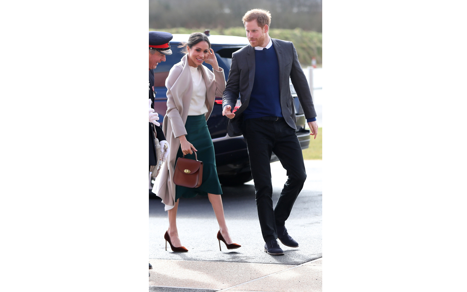 Meghan Markle's Sweater Is the  Perfect Transitional Piece to Pack for Any Spring Trip