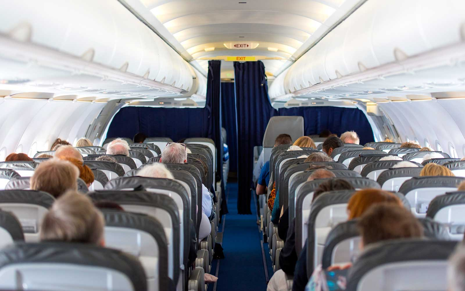 Commercial aircraft cabin with passengers