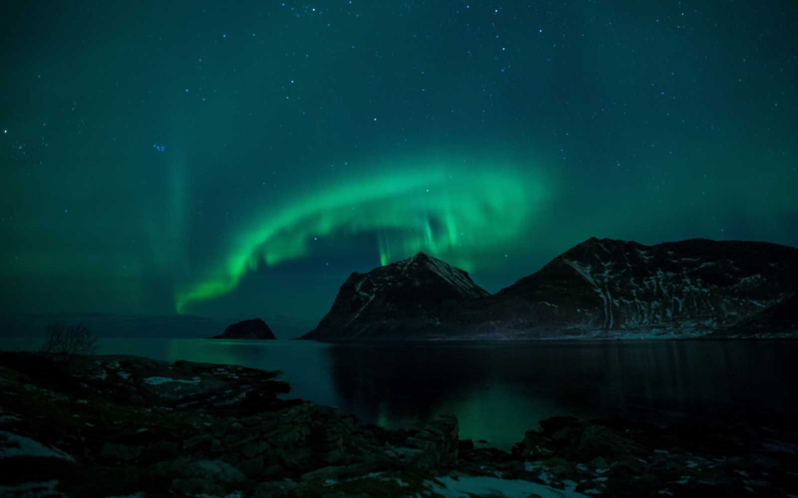 Northern Lights are pictured on March 9, 2018, in Utakleiv, northern Norway, Lofoten islands, within the Arctic Circle.