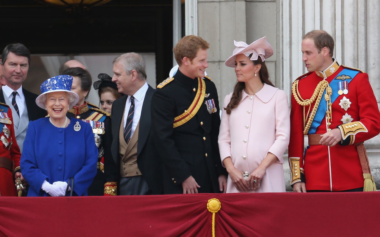 Queen Elizabeth II laughs next to Prince Harry, Catherine, Duchess of Cambridge and Prince William, Duke of Cambridge stand on the balcony at Buckingham Palace d