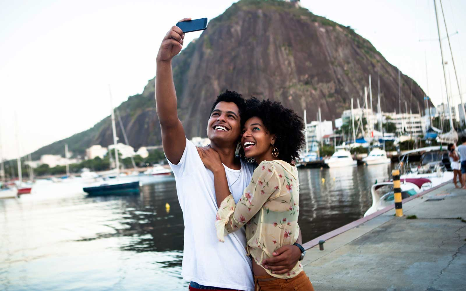 Couple taking a selfie by boats