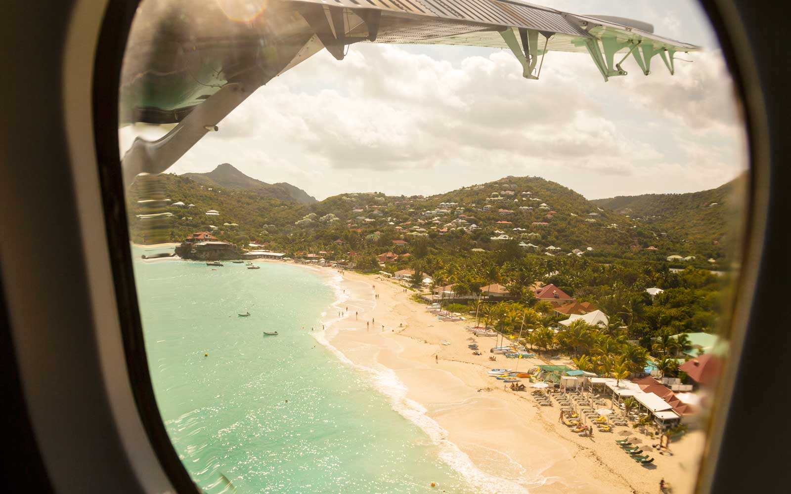 View of beach from the window of an airplane