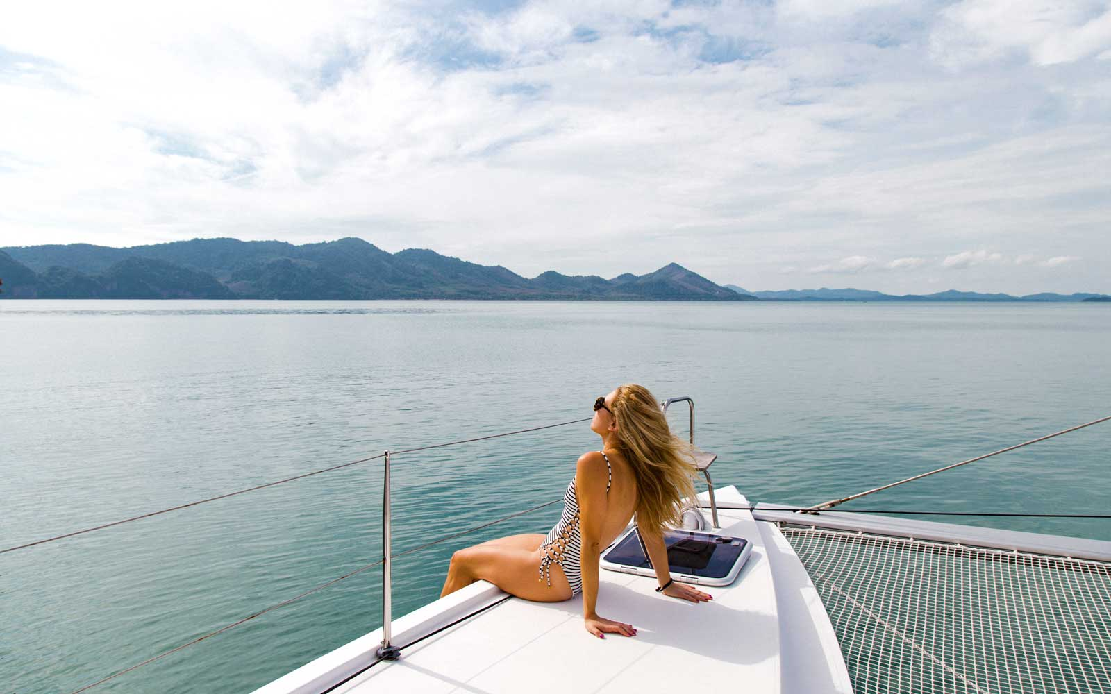 On a boat in Thailand during a Free People Escapes-led trip