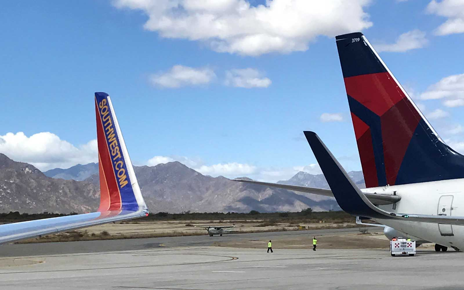 Tails of Delta and Southwest planes with views of the mountains