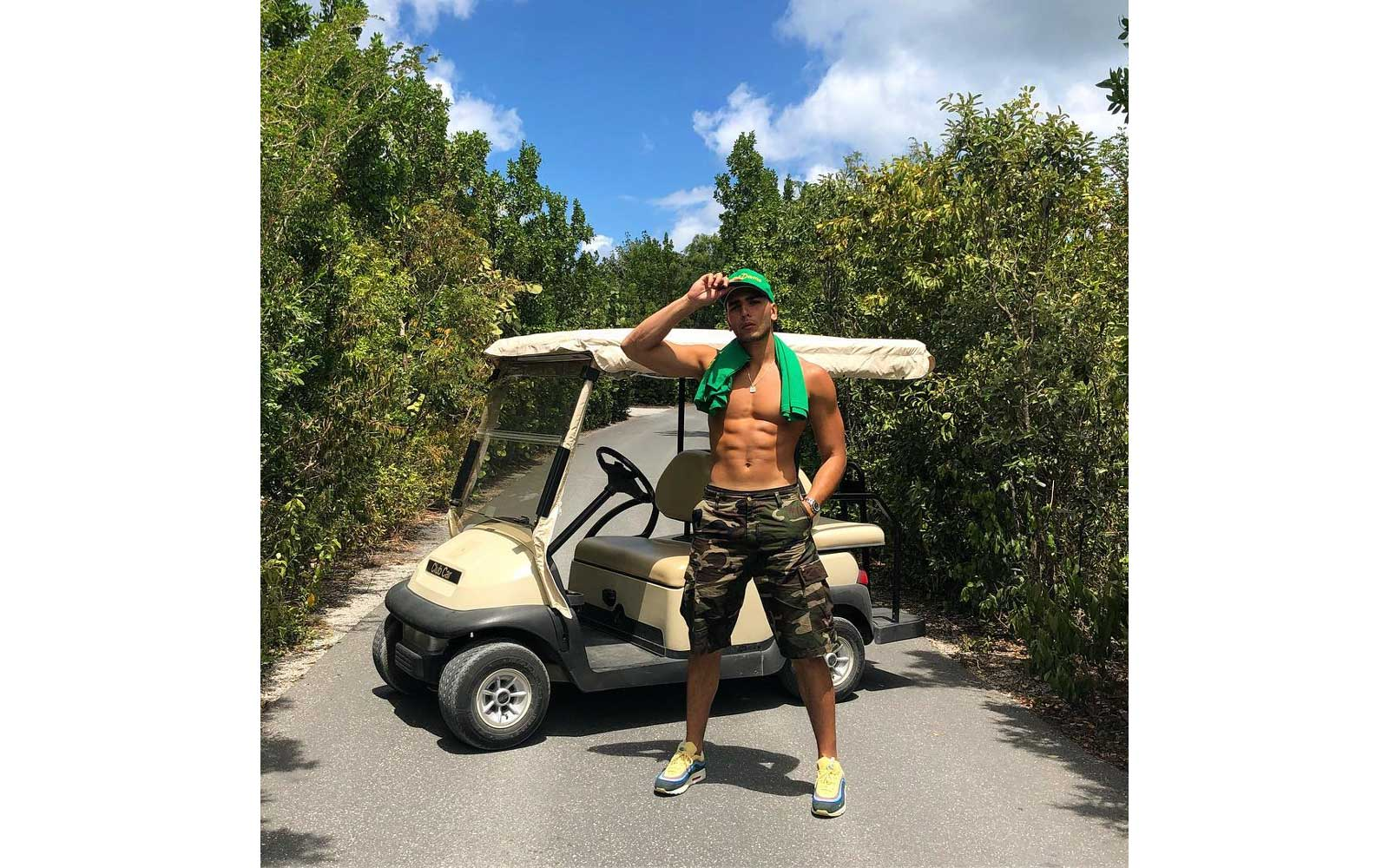 Younes Bendjia in front of a golf cart in Turks & Caicos