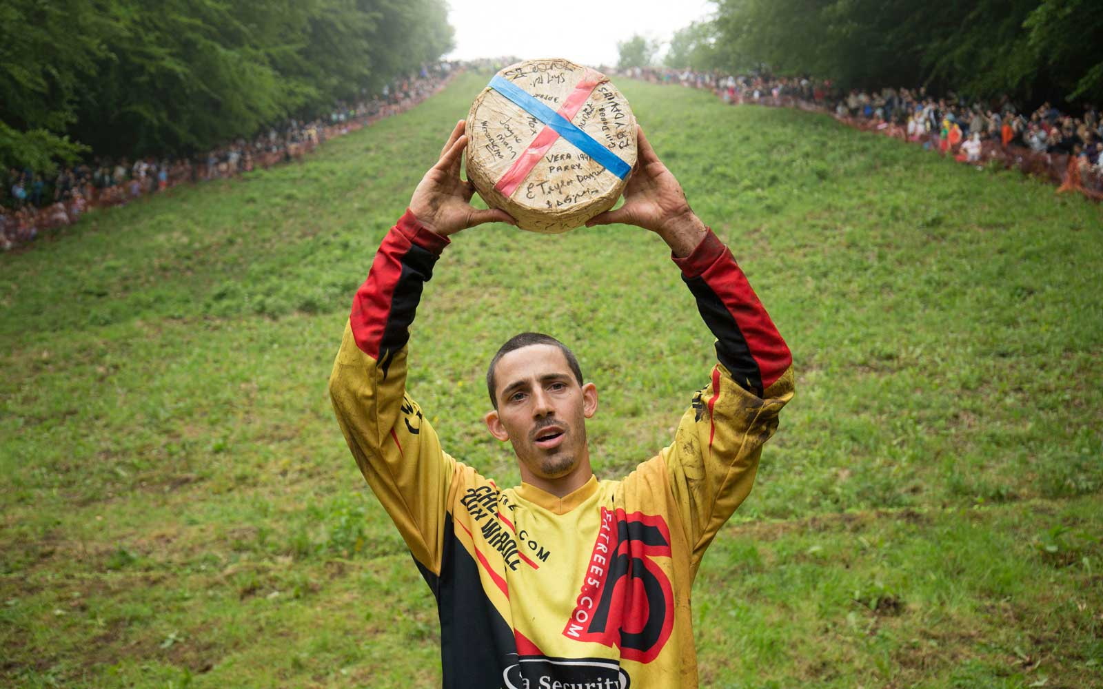 Chris Anderson, 30, who has broken the all-time record for the most cheeses won in the death-defying Cheese Rolling Race at Cooper's Hill in Brockworth, Gloucestershire