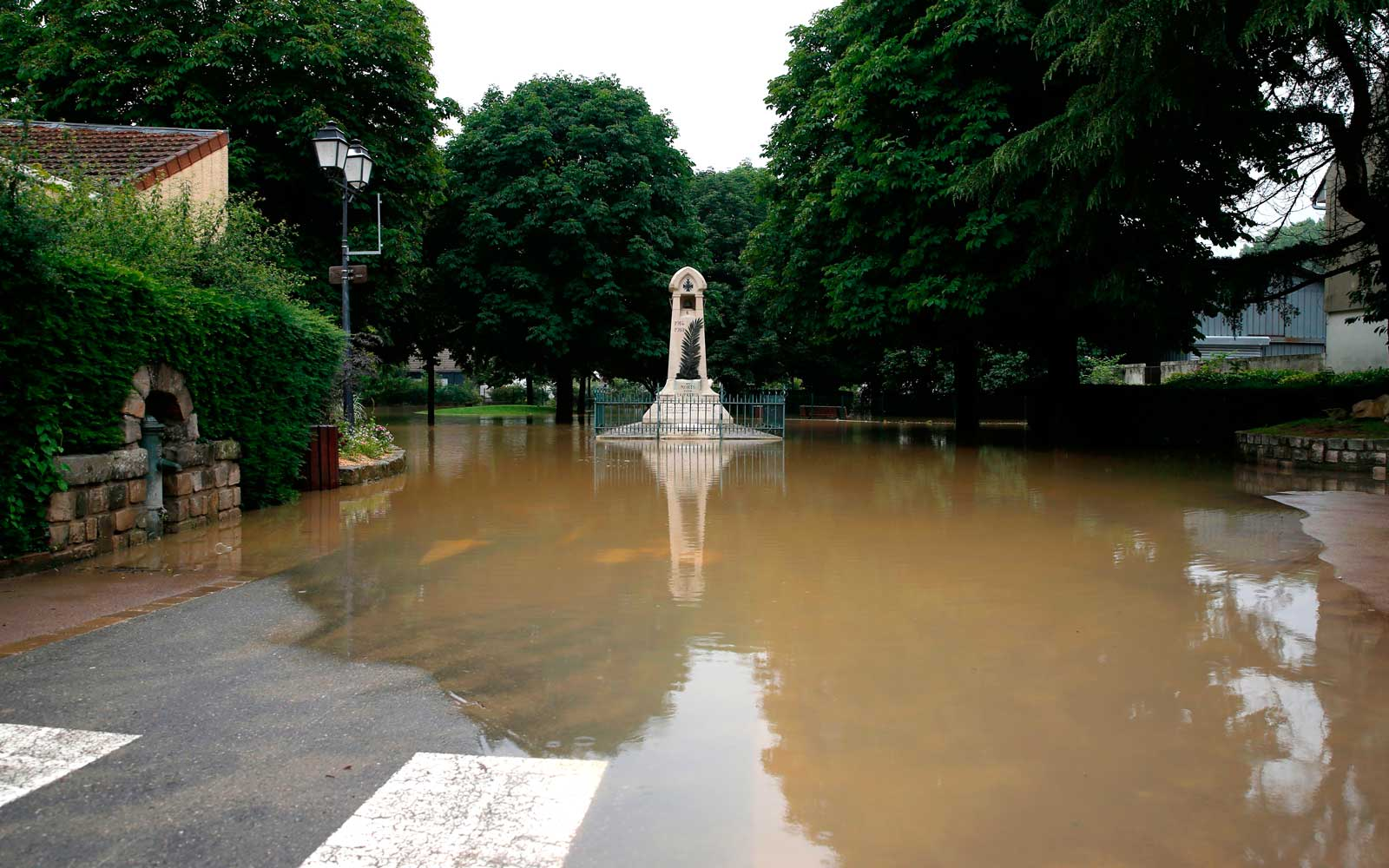 June 12, 2018 in Saint-Remy-les-Chevreuse shows a flooded street following heavy rains.
