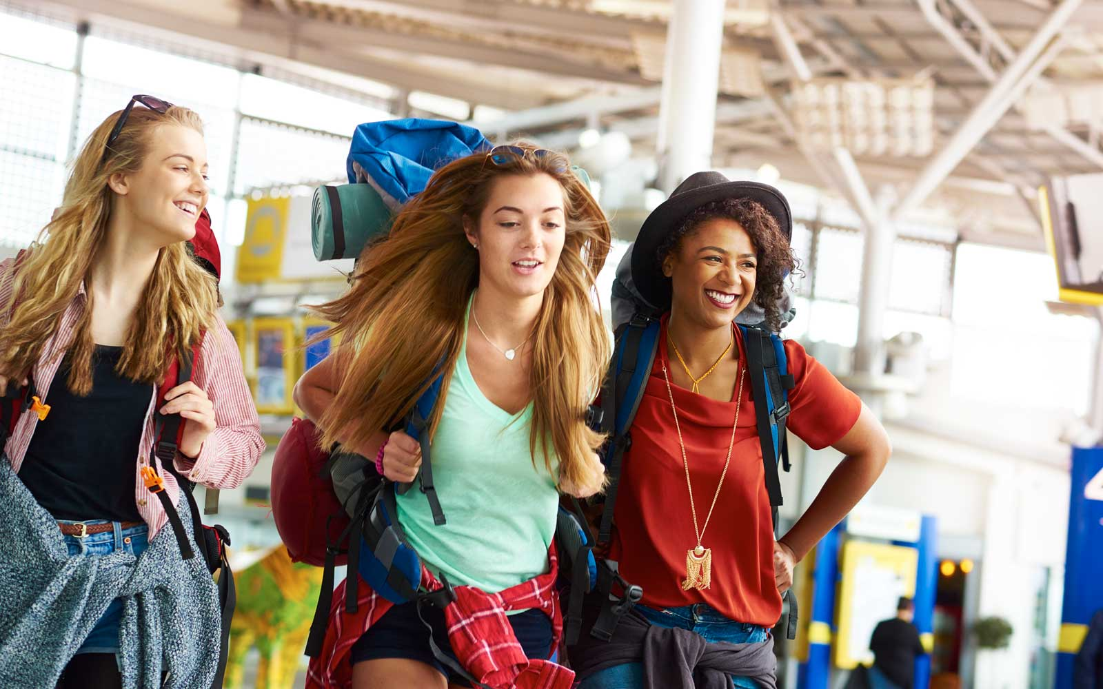Backpacking friends undertake the next part of their journey