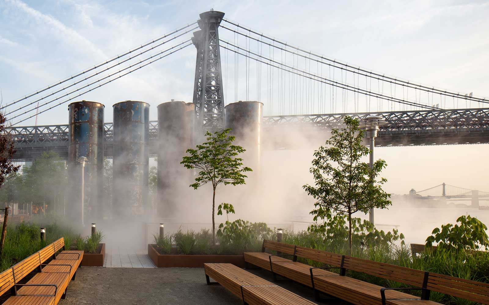 View for eh syrup tanks with the fog feature activated, at Domino Park in New York